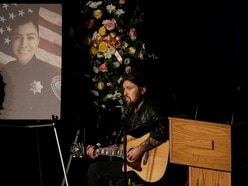 Billy Ray Cyrus sings at memorial service for murdered policewoman