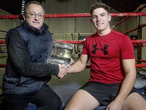 Ring-fenced prize: Sports editor Rob Batiste hands over the Sporting Achievement of the Year trophy to boxer Billy Le Poullain. (Picture by Ben Fiore)
