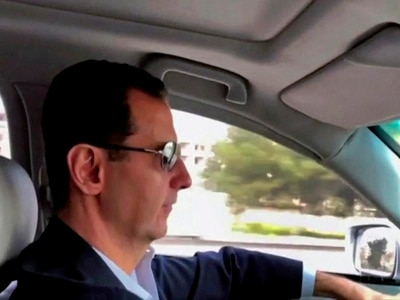 Syrian president pictured driving himself into Ghouta battle zone
