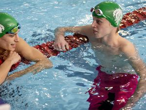 How was it for you?: Samuel Bourgaize (left) and Samuel Lowe discuss their  200m backstroke performances.(Picture by Sophie Rabey, 28961948)