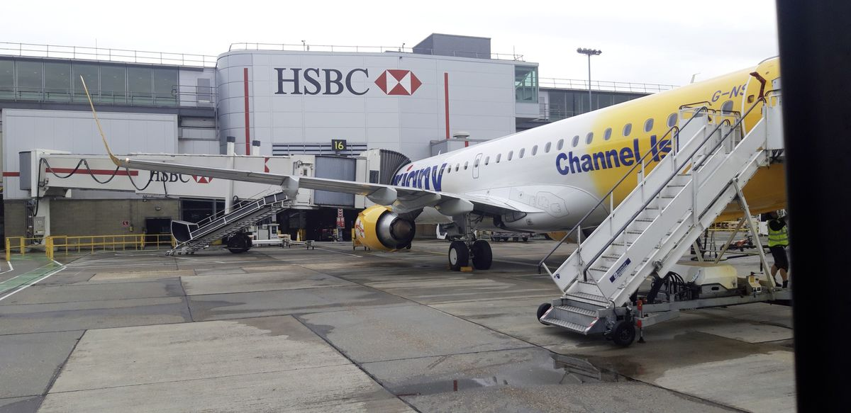 Aurigny's Embraer 195 at the gate at Gatwick Airport in June 2019. (29314704)
