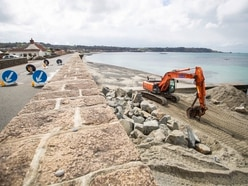 Coast road opens but repairs go on