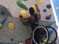 Student in wheelchair scales climbing wall after just a week's practice