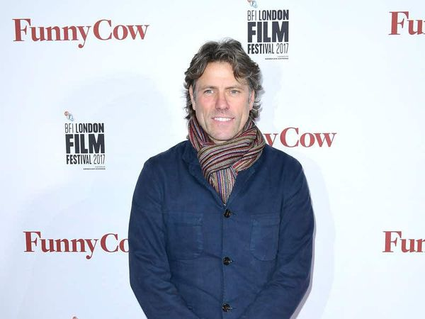 John Bishop donates 100 laptops to pupils at his old school