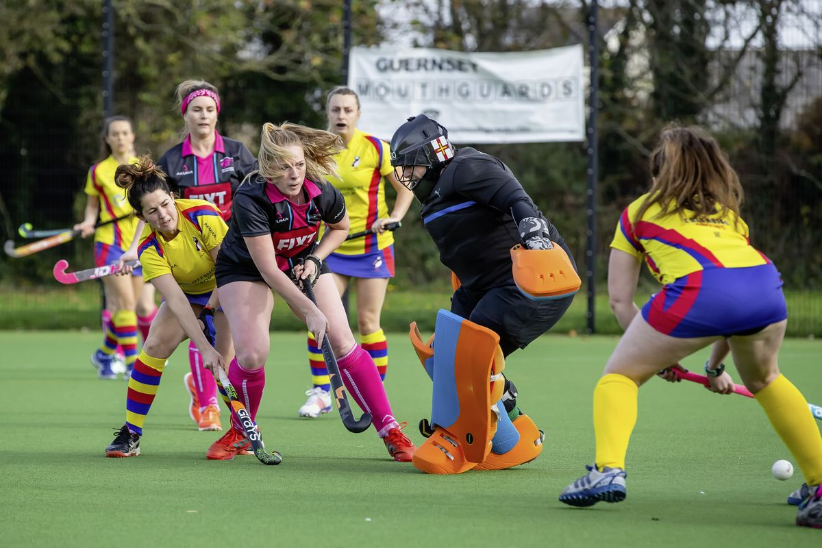 Becky McAllister scores one of her two goals for Panthers against Puffins. (Picture by Martin Gray, www.guernseysportphotography.com, 28887799)