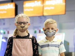 Comic book face mask covers to help ease children's anxiety about flight rules