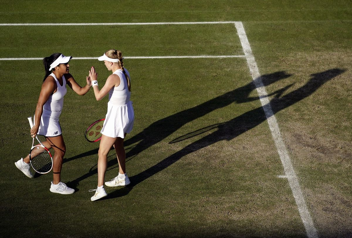 Heather Watson and Harriet Dart during their win at Wimbledon on Saturday. (Picture PA Wire, 29725841)