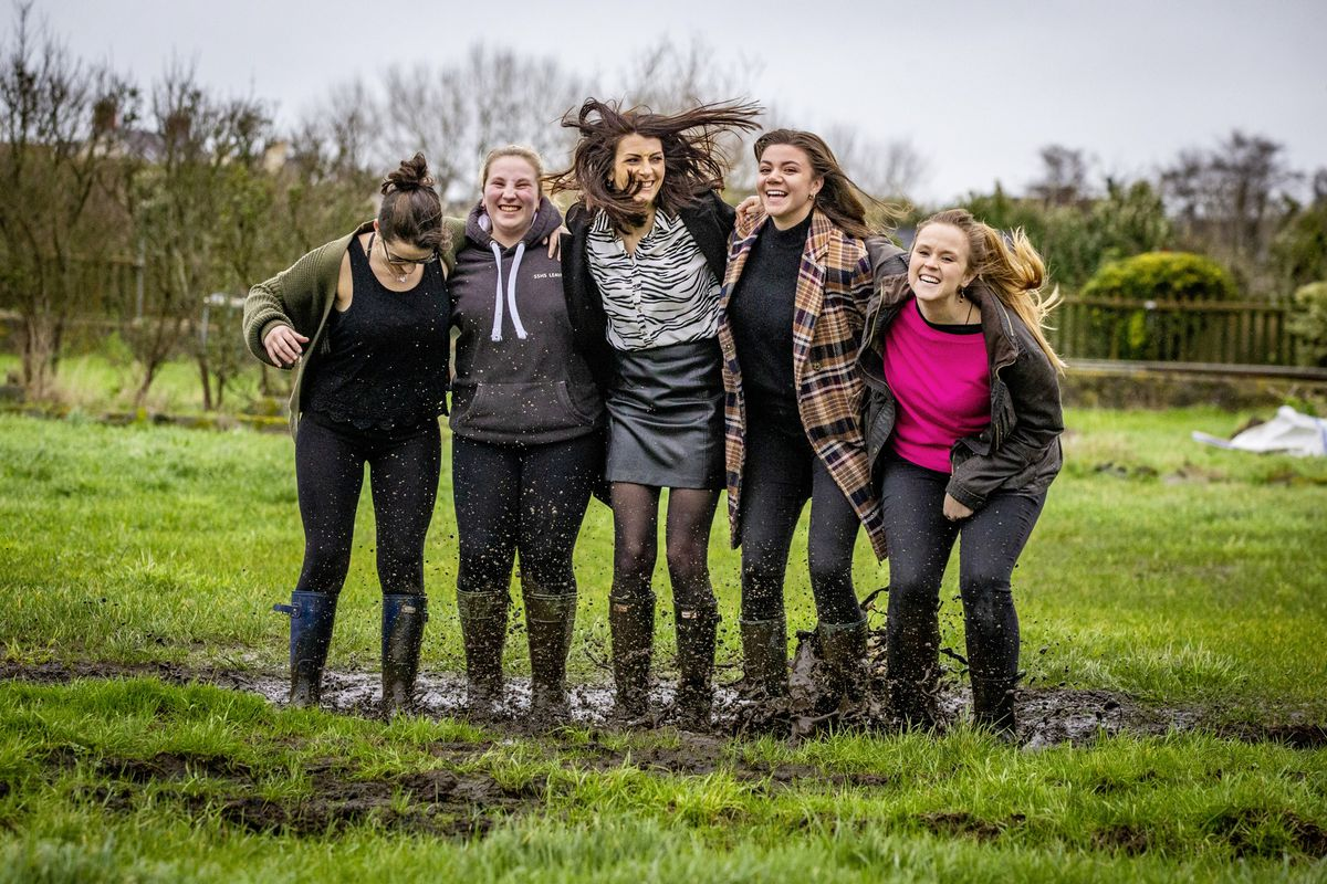 Guernsey Press staff Emily Hubert, Cassidy Jones, Ashley Miles, Zoe Fitch and Sophie Rabey donned wellies and jumped in a mucky puddle to raise money for Cancer Research UK. (Picture by Peter Frankland, 29103940)