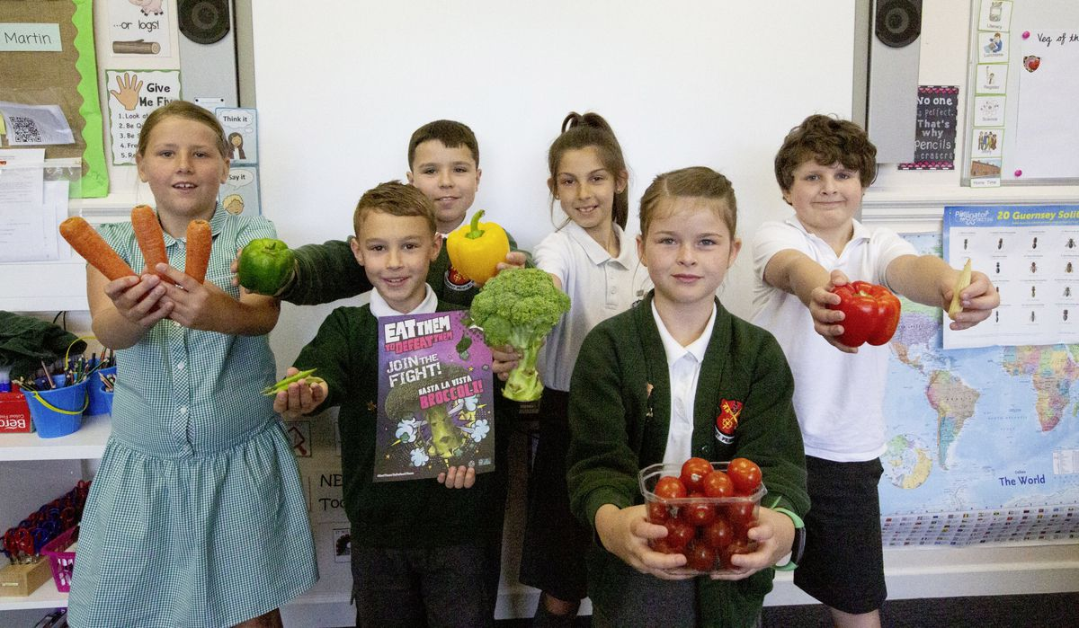 Amherst Primary Year 4 students with free vegetables as part of a campaign to encourage students to eat healthily. Left to right, back, Caitlin Ward and Zachary Gill, both 9, Amari Zekavica, 8, and Archie Stone, 9, and in front, Jake Blampied, 8, and Chloe Fallaize, 9. (Picture by Cassidy Jones, 29641065)