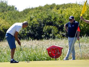 Golf in green and peaceful lands: The now retired Chris Vermeulen putts watched by John Dent, the director of golf at the course since late 2017. With the sale the latter has a key role in the future improvement of the course.(Picture by Gareth Le Prevost, 21826030)