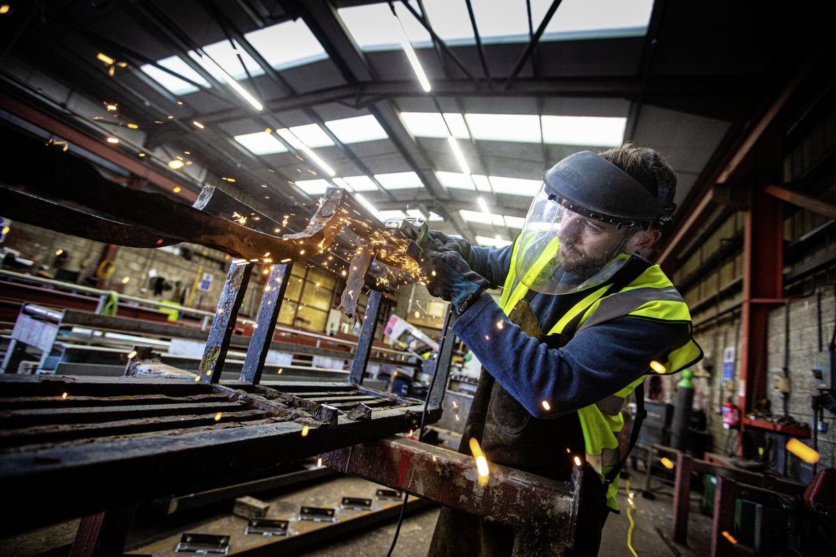 Picture By Peter Frankland. 22-10-20 Rory Moriarty, welder / fabricator at Channel Welders, working on the Elizabeth College gates which the company are restoring.. (28828016)