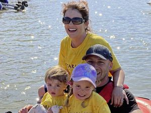 Jonny Veron at the end of his long row around the island, relaxing with wife Jenna and children Edward, 2, and Charlotte, 4.