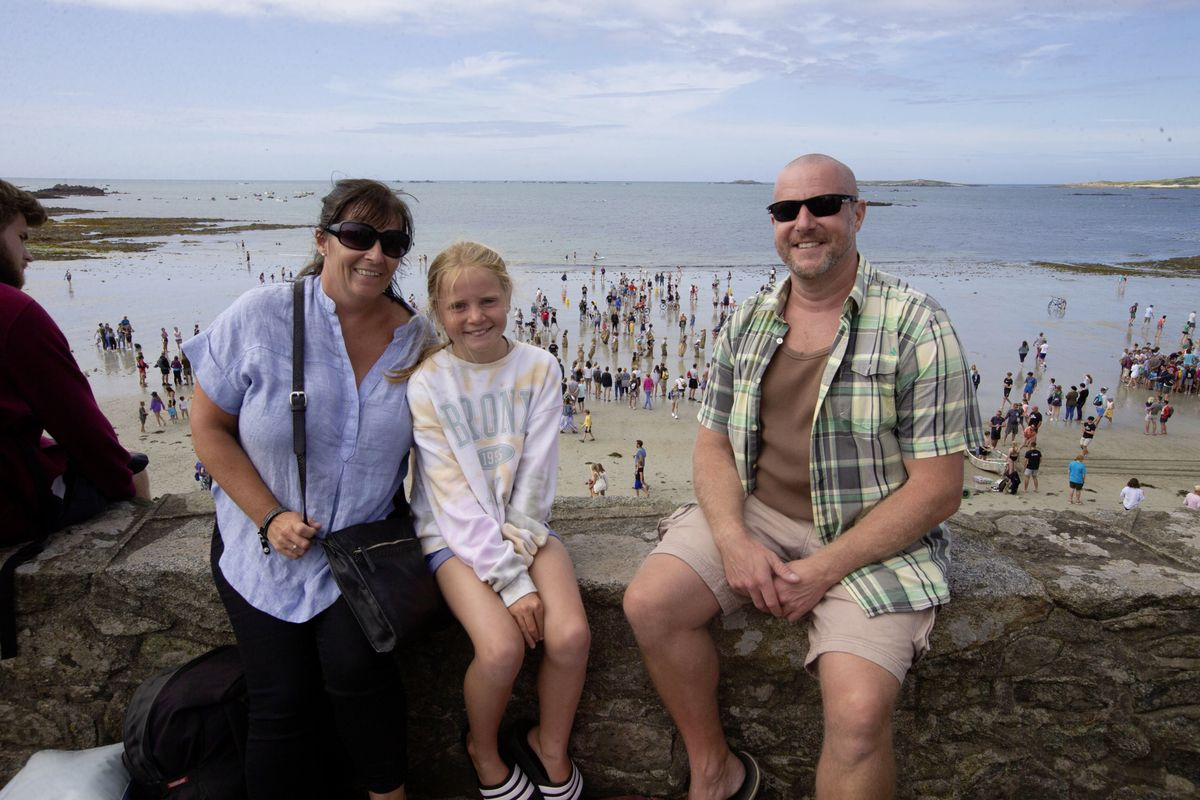 Ashley Price, Maisie Johns, 10, and Richard Johns watched events from the sea wall. (29822235)