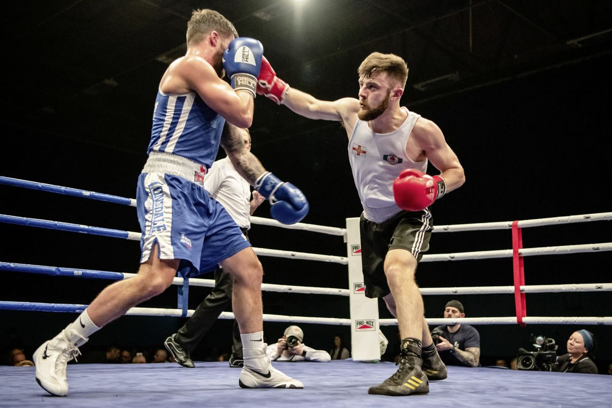 Top of the bill bout: Chris Sumner lands a right hand on opponent Keiran Bailey at Beau Sejour. (Picture by Andrew Le Poidevin, 27254182)