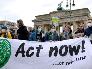 Campaigners stage climate protests across continents