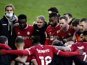 Guernsey footballer Alex Scott (far right wearing orange bib) in the Bristol City team huddle after their 3-1 win away at Swansea City in the Sky Bet Championship. It was the first time Scott has been involved in the Bristol City first team match-day squad.