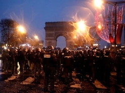 Police use tear gas on the Champs-Elysees, but fewer Paris protesters