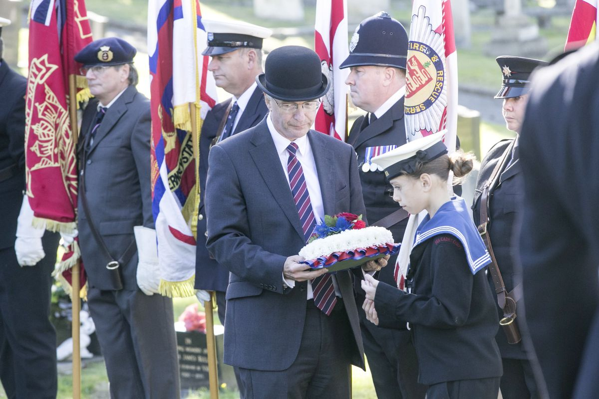 Pic by Adrian Miller 27-09-20 Foulon Cemetery. Remembrance service for H.M.S. Charybdis and H.M.S. Limbourne . Wreath Bearer Cadet Browning 13 of the Sea Cadets leads the Bailiff Richard McMahon. (28735069)