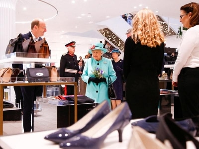 Queen browses store's hat selection during visit to revamped Bracknell
