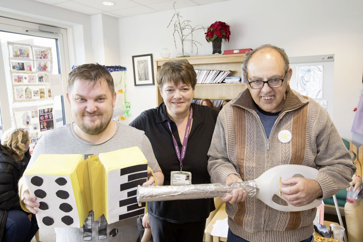 Outreach support worker Viv Torode, centre, whose attic produced a lot of the raw materials for the projects, with Ryan Ozanne, left, with his accordion, and John Belloeil with his guitar. (28823917)