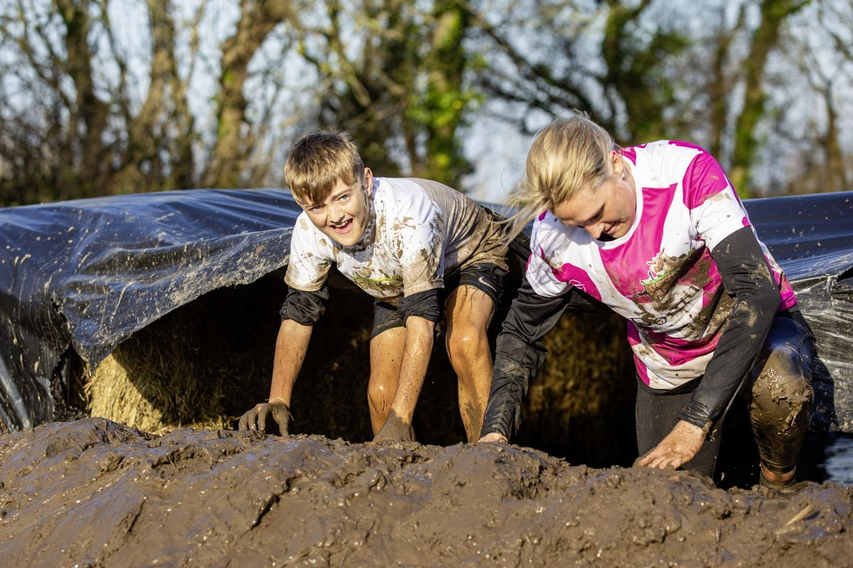 Picture by Sophie Rabey.  29-11-20. Muddy Cow Fun Run Vazon/Grande Mare. Oliver Granville (11) on his birthday and Sarah Jarvis. (28963032)
