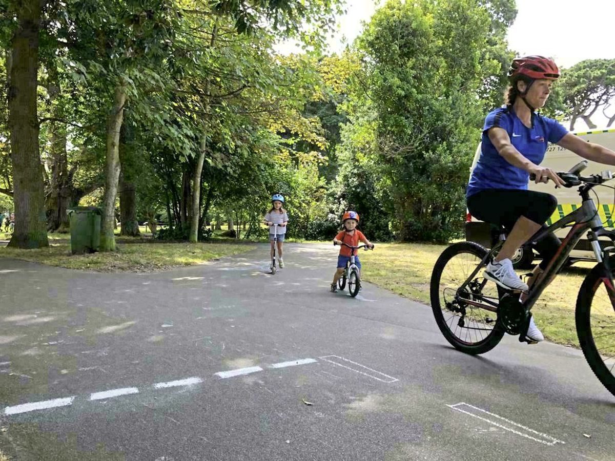 Cyclists enjoying the trial chalked bike park during the Health Improvement Commission's family fun day in August. (Picture supplied by Alun Williams)