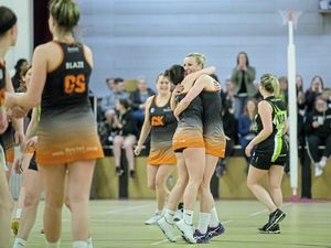 Nerine Blaze captain Nena Copperwaite hugs a teammate at the final whistle in last night's title decider with Resolution IT A at the Grammar School. (Picture by Peter Frankland, 24321049)