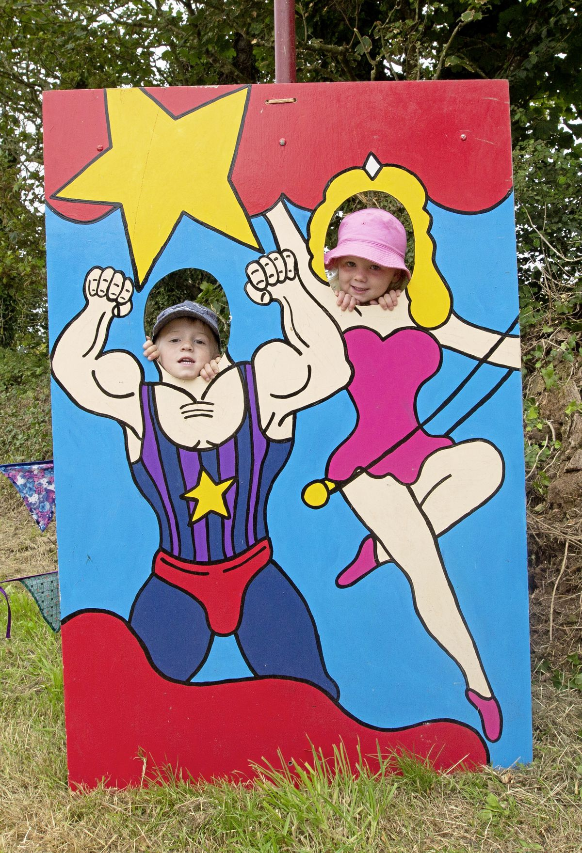 Snap! Oskar and Rosie Gillam pose for a photo in the circus strongman and trapeze artist prop.  (29822287)